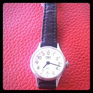 Vintage timex watch with leather band.